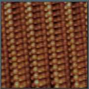 Surface de matériau organique (TTFTCNQ) à 63K observée en microscopie tunnel.